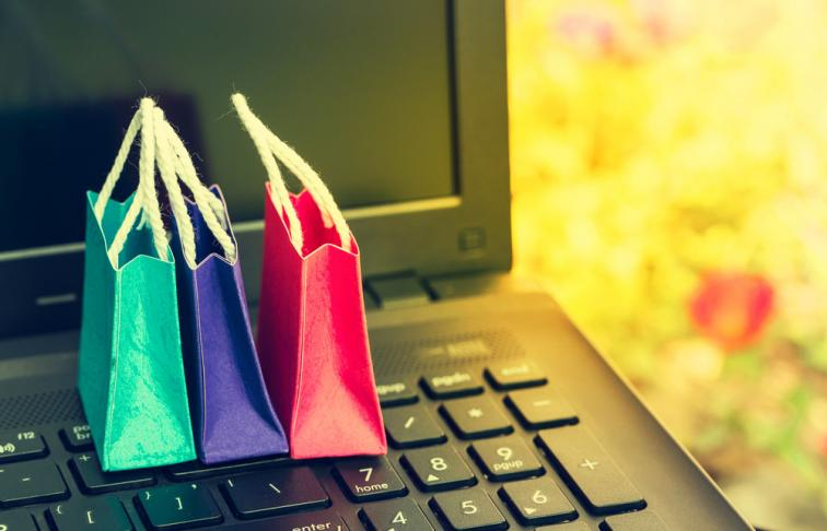 Shopping bags with computer keyboard, symbolising online shopping
